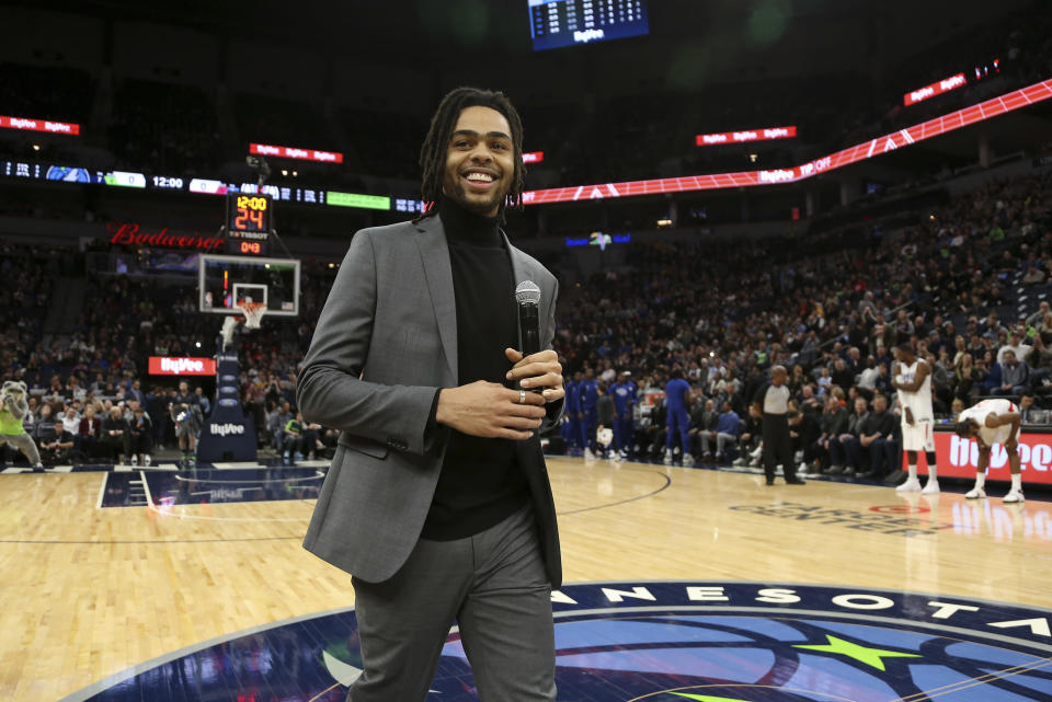 Minnesota Timberwolves' D'Angelo Russell smiles after addressing team fans prior to an NBA basketball game against the Los Angeles Clippers, Saturday, Feb. 8, 2020, in Minneapolis. (AP Photo/Stacy Bengs)