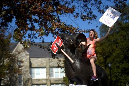Grace Crowley, 21, a West Chester University senior, demonstrates with university employees from the APSCUF union representing 5,500 Pennsylvania university and college employees after failing to reach a contract deal with the state education system in West Chester, Pennsylvania, U.S., October 19, 2016. REUTERS/Mark Makela