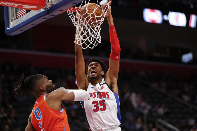 Detroit Pistons forward Christian Wood (35) dunks on Oklahoma City Thunder center Nerlens Noel (9) in the first half of an NBA basketball game in Detroit, Wednesday, March 4, 2020. (AP Photo/Paul Sancya)