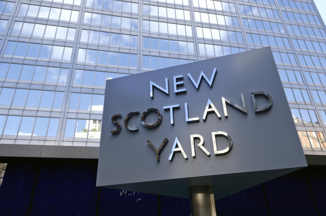 """""""London, United Kingdom - September 22, 2012: New Scotland Yard, London. Iconic rotating sign outside New Scotland Yard, headquarters of the Metropolitan Police who are responsible for policing Greater London. The sign, which is a tourist attraction, has recently been moved as it was causing congestion at the main entrance to the building."""""""