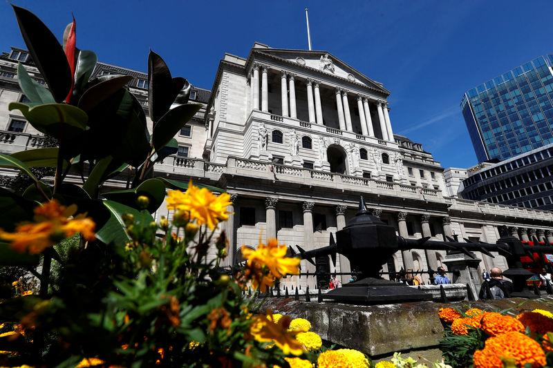 FILE PHOTO: Flowers in bloom are sen opposite the Bank of England, in London