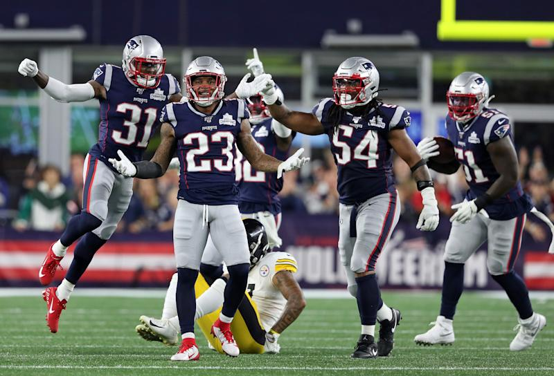 Jonathan Jones, Patrick Chung, Dont'a Hightower and Ja'Whaun Bentley celebrate after Chung broke up a fourth-and-1 pass attempt.