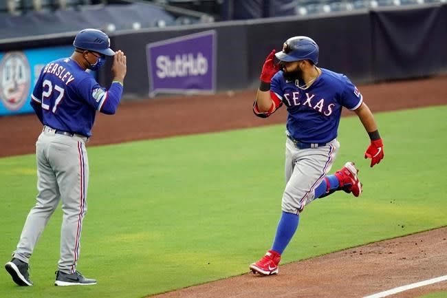 Machado's grand slam in 10th lifts Padres over Rangers 6-3