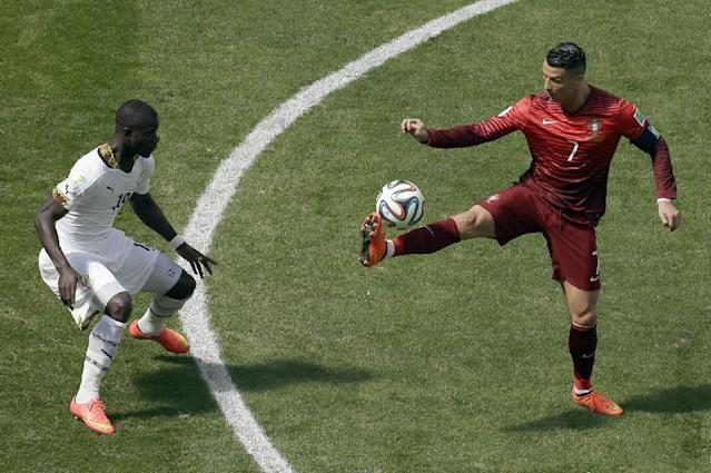 Portugal's Cristiano Ronaldo, right, controls the ball watched by Ghana's Jonathan Mensah during the group G World Cup soccer match between Portugal and Ghana at the Estadio Nacional in Brasilia, Brazil, Thursday, June 26, 2014. (AP Photo/Themba Hadebe)