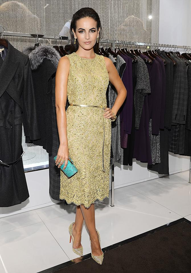 "If you can get past her terrifying pout, you'll notice that Camilla Belle's lace Michael Kors cocktail frock is fierce. Look at that intricate beading! A sleek 'do, smokey makeup, sexy gold belt, snakeskin clutch, and Christian Louboutin pumps completed her nearly flawless look. (9/13/2012)<br><br><a target=""_blank"" href=""http://omg.yahoo.com/photos/ny-fashion-week-1347312434-slideshow/"">Celebs hit NY Fashion Week</a>"