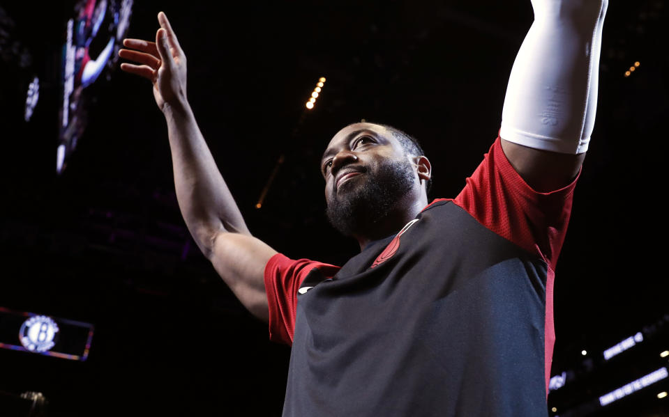 Miami Heat guard Dwyane Wade (3) acknowledges cheers from the crowd before the start of the final NBA basketball game of his career, Wednesday, April 10, 2019, against the Brooklyn Nets in New York. (AP Photo/Kathy Willens)