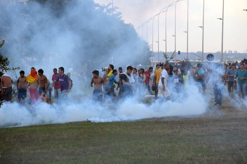 Police in the Brazilian capital fired tear gas to break up a protest by Indian chiefs and groups opposed to the money being spent to host the World Cup