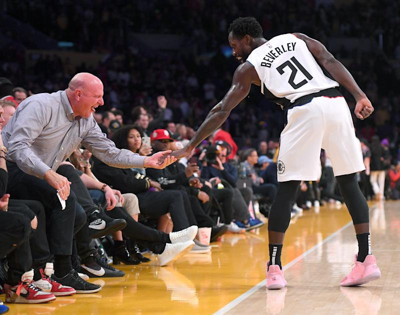 LOS ANGELES, CA - DECEMBER 25: Patrick Beverley #21 gets a high five from Los Angeles Clippers owner Steve Balmer during the game against the Los Angeles Lakers at Staples Center on December 25, 2019 in Los Angeles, California. NOTE TO USER: User expressly acknowledges and agrees that, by downloading and/or using this Photograph, user is consenting to the terms and conditions of the Getty Images License Agreement. (Photo by Jayne Kamin-Oncea/Getty Images)