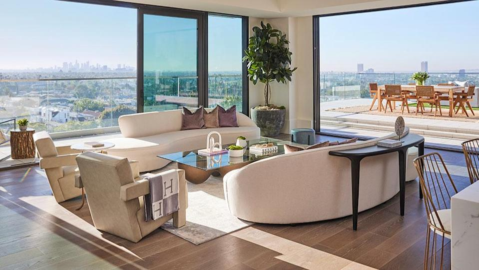 A living room at Pendry Residences West Hollywood opens on to a terrace. - Credit: Photo: Justin Coit