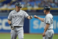 New York Yankees' DJ LeMahieu, left, celebrates with first base coach Reggie Willits after hitting a single off Tampa Bay Rays starting pitcher Michael Wacha during the third inning of a baseball game Wednesday, July 28, 2021, in St. Petersburg, Fla. (AP Photo/Chris O'Meara)