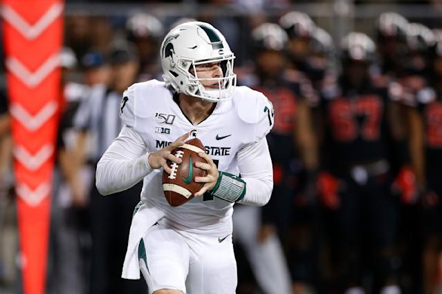 Michigan State quarterback Brian Lewerke drops back to pass against Ohio State during the first half of an NCAA college football game Saturday, Oct. 5, 2019, in Columbus, Ohio. (AP Photo/Jay LaPrete)