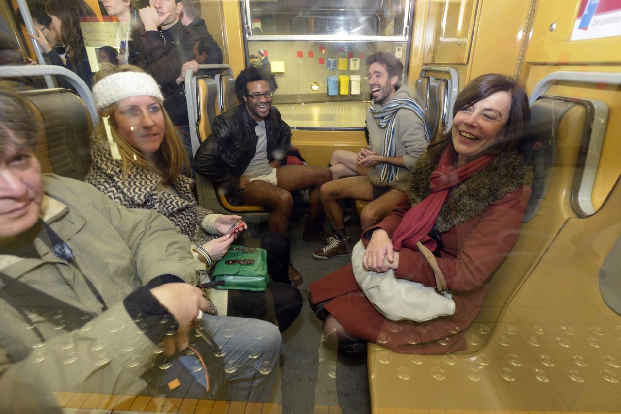 """People take part in the annual """"No Pants Subway Ride"""" in the subway in Brussels"""