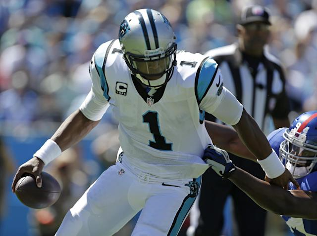 Carolina Panthers quarterback Cam Newton (1) is tackled by New York Giants defensive end Mathias Kiwanuka (94) during the first half of an NFL football game in Charlotte, N.C., Sunday, Sept. 22, 2013. (AP Photo/Bob Leverone)