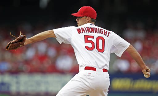 St. Louis Cardinals starter Adam Wainwright pitches in the first inning of a baseball game against the Houston Astros, Tuesday, July 9, 2013, in St. Louis.(AP Photo/Tom Gannam)