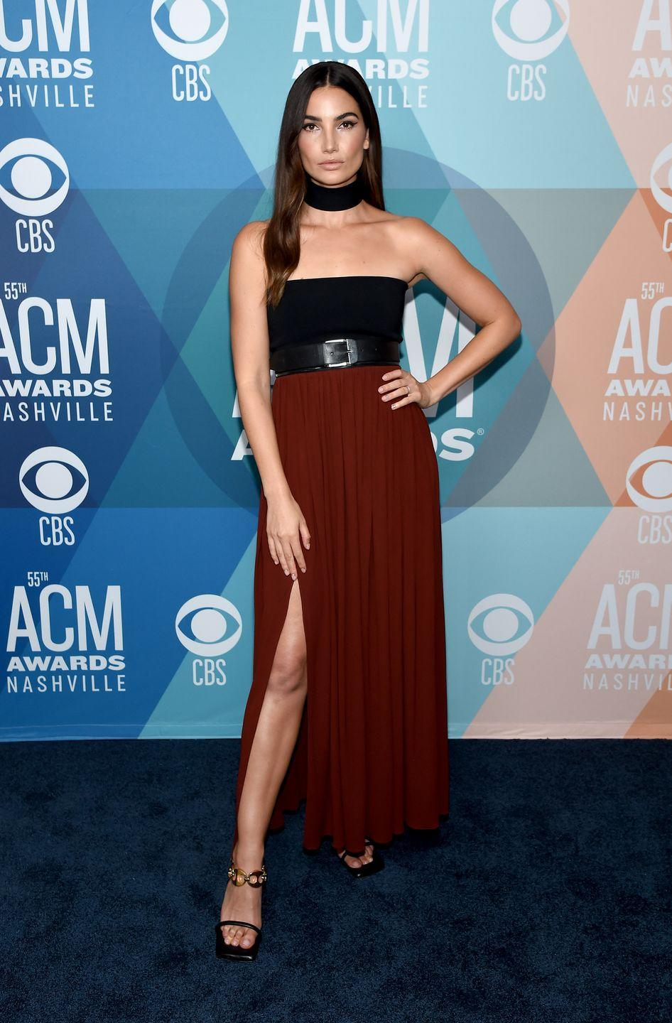 <p><strong>16 September</strong> Lily Aldridge attended the Academy of Country Music Awards in Nashville wearing a belted strapless Proenza Schouler dress. </p>