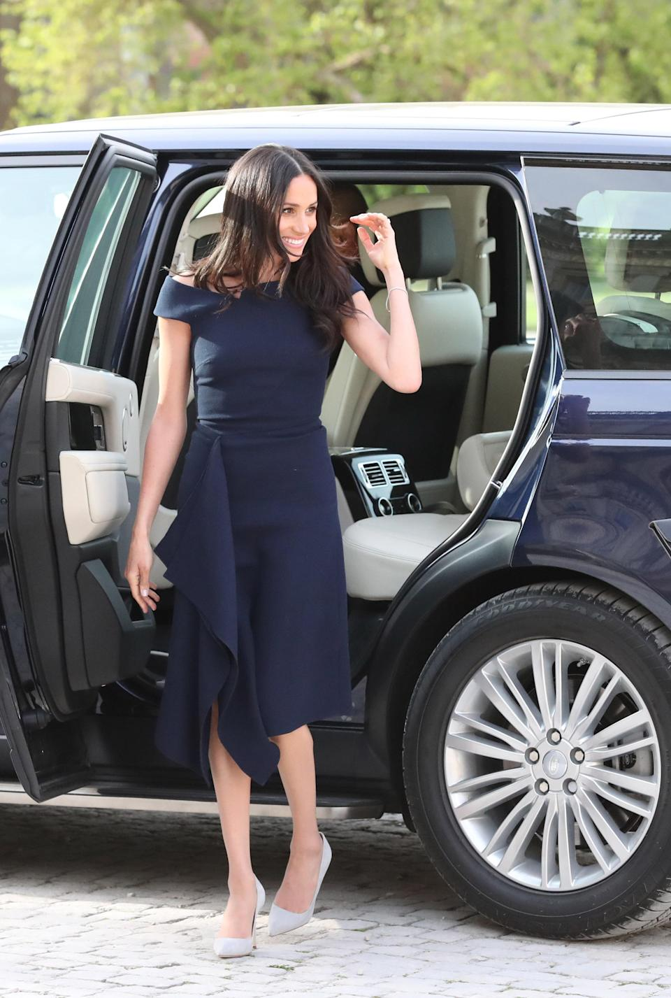 <p>Meghan Markle and her mother, Doria Ragland, arrived at Cliveden House Hotel on the National Trust's Cliveden Estate to spend the night before her wedding to Prince Harry. For the occasion, the Duchess-to-be paired a navy Roland Mouret dress with pale pumps. <em>[Photo: Getty]</em> </p>