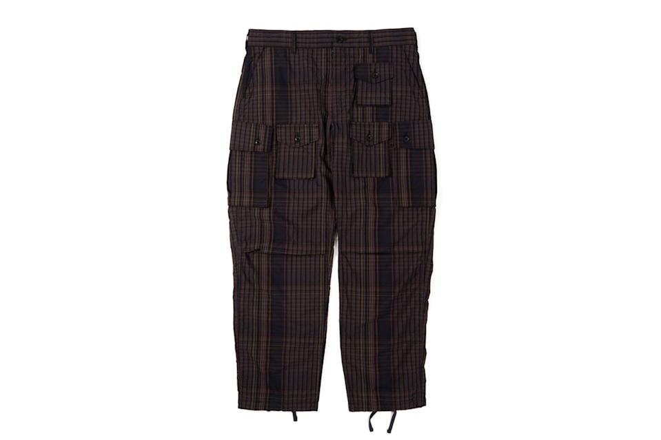 "$456, Nepenthes NY. <a href=""https://nepenthesny.com/collections/new-arrivals/products/fa-pant-multi-color-nyco-plaid?variant=38093540032688"" rel=""nofollow noopener"" target=""_blank"" data-ylk=""slk:Get it now!"" class=""link rapid-noclick-resp"">Get it now!</a>"