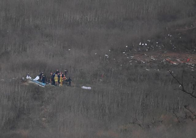 Jan 26, 2020; Calabasas, California, USA; Members of LA County Fire and LA County corners begin the task of removing bodies from the hillside where the helicopter carrying Kobe Bryant and 8 others crashed in Calabasas, CA. Mandatory Credit: Jayne Kamin-Oncea-USA TODAY Sports
