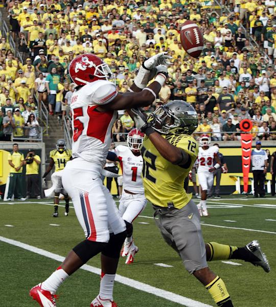 Oregon defender Brian Jackson, right, breaks up a pass intended for Fresno State receiver Davante Adams during the first half of an NCAA college football game in Eugene, Ore., Saturday, Sept. 8, 2012. (AP Photo/Don Ryan)