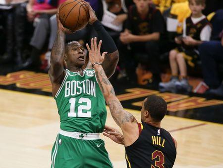May 19, 2018; Cleveland, OH, USA; Cleveland Cavaliers guard George Hill (3) defends Boston Celtics guard Terry Rozier (12) during the first quarter in game three of the Eastern conference finals of the 2018 NBA Playoffs at Quicken Loans Arena. Mandatory Credit: Aaron Doster-USA TODAY Sports