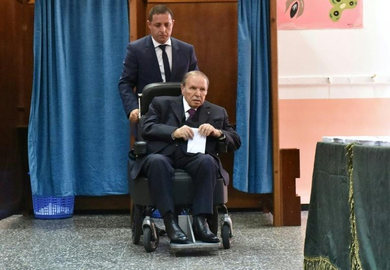Algerian President Abdelaziz Bouteflika is seen on a wheelchair as he votes at a polling station in Algiers on May 4, 2017