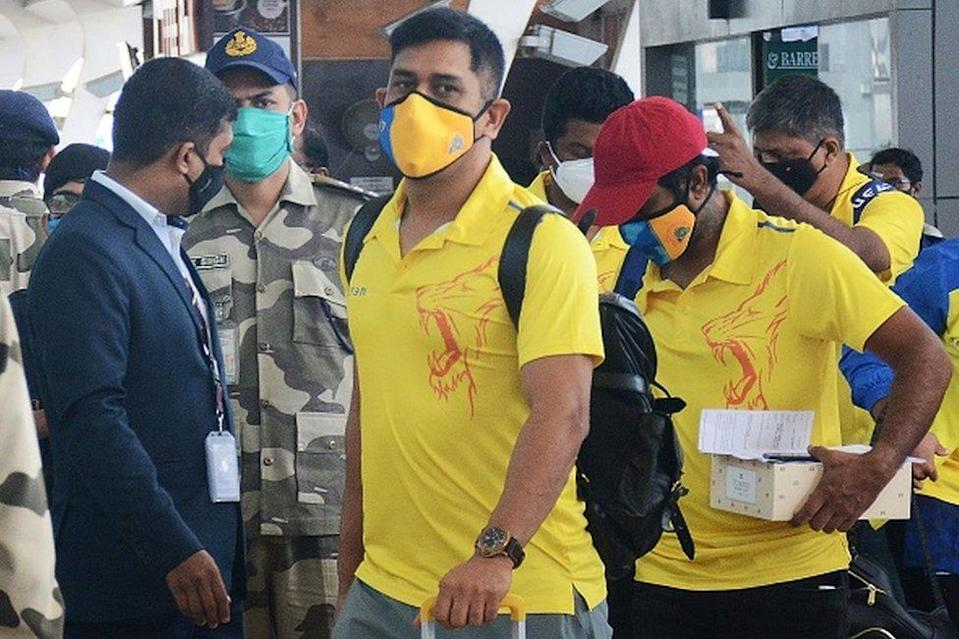 Chennai Super Kings captain Mahendra Singh Dhoni (C) arrives along with his teammates at the airport to take a flight to Dubai for the Indian Premier League (IPL) cricket tournament, in Chennai on August 21, 2020.