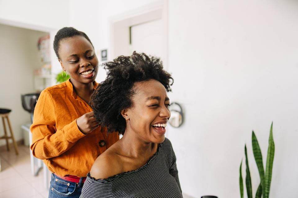 Real, lasting relationships are formed in the salon chair in the Black community, says one writer. (Stock photo/Getty Images)