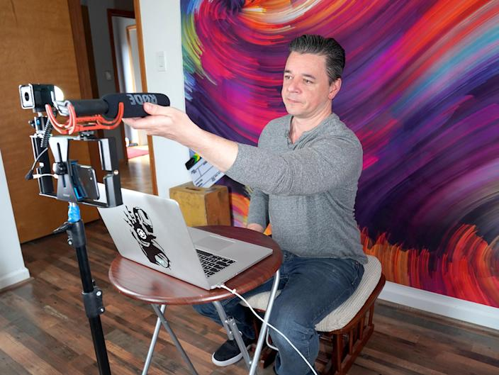 A video producer works from his at-home studio to conduct remote interviews with talent on April 19, 2020 in Franklin Square, New York. (Photo by Eric Stringer/Getty Images)