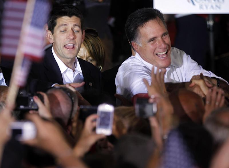 FILE - In this Aug. 11, 2012, file photo, Republican presidential candidate, former Massachusetts Gov. Mitt Romney, right, and vice presidential running mate, Rep. Paul Ryan, R-Wis., left, greet supporters, during a campaign rally in Manassas, Va. For all the attention it got, Romney's selection of Ryan as his running mate has not altered the race against President Barack Obama. The campaign remains a dead heat with less than three months to go, a new Associated Press-GfK poll shows. (AP Photo/Pablo Martinez Monsivais, File)