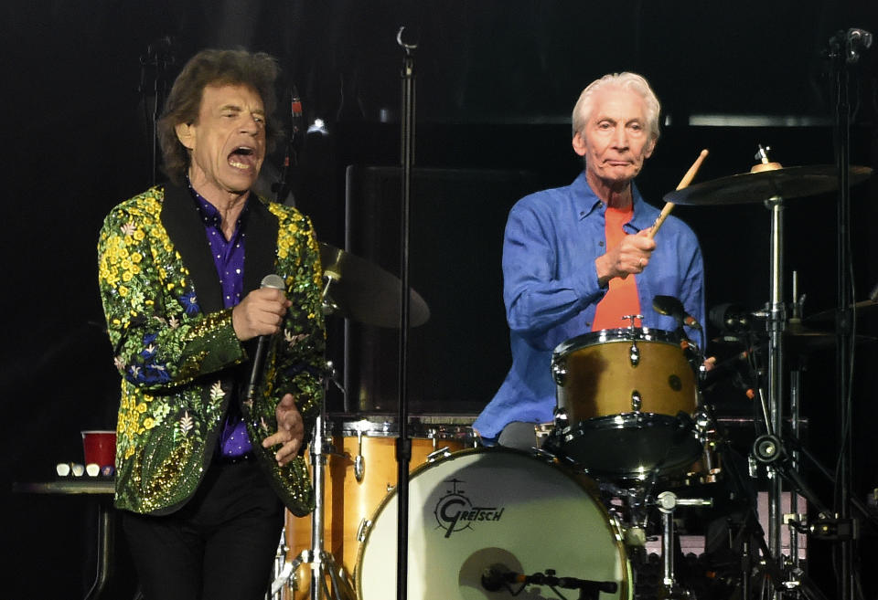 Rolling Stones drummer Charlie Watts, right, performs behind singer Mick Jagger during their concert at the Rose Bowl, in. 2019. Source: AAP