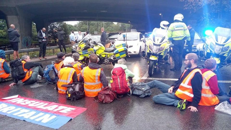 A demo on at Junction 3 of the M4 near Heathrow Airport (Insulate Britain/PA) (PA Media)
