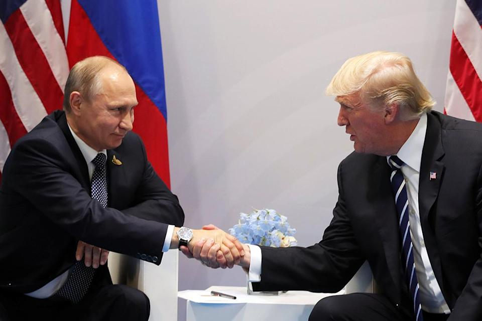 The report claims Vladimir Putin had a hand in Donald Trump getting elected as US president in 2016 (EPA)