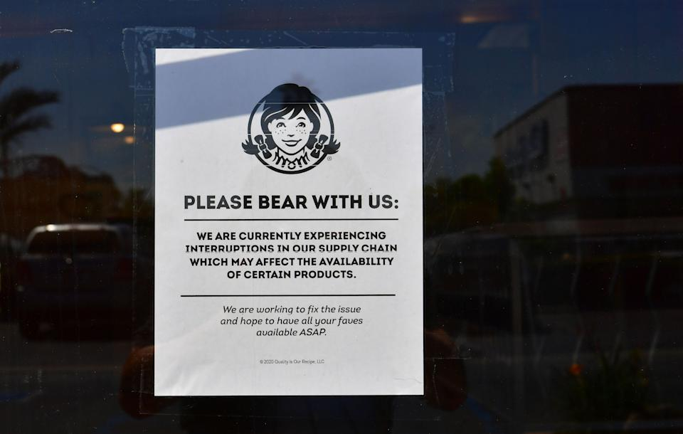 """A sign posted on a walk-in entrance to a Wendy's fast food restaurant in Alhambra, California on May 5, 2020. - A sign displayed on the walk-in entrance mentions an interruption in supply chain affecting availability of certain products. Wendy's, an international chain restaurant famous for the 1984 catchphrase """"Where's the Beef?"""" is experiencing a beef shortage caused by the coronavirus pandemic, as some restaurants stop serving burgers. (Photo by Frederic J. BROWN / AFP) (Photo by FREDERIC J. BROWN/AFP via Getty Images)"""