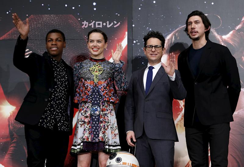 "Director J.J. Abrams (2nd R), cast members John Boyega (L), Daisy Ridley (2nd L), and Adam Driver pose for pictures with Star Wars character BB-8 8(C) during a news conference for their upcoming movie ""Star Wars: The Force Awakens"" in Urayasu, Chiba prefecture, the suburbs of Tokyo, Japan, December 11, 2015. REUTERS/Yuya Shino"