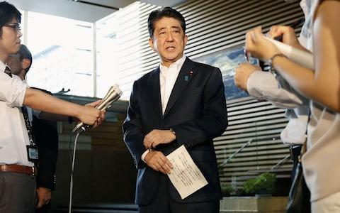 Japanese Prime Minister Shinzo Abe speaks to reporters about North Korea's missile launch in Tokyo - Credit: Reuters