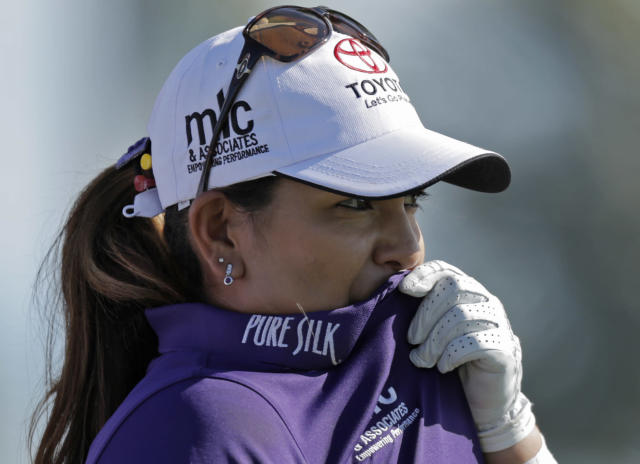 Lizette Salas of the U.S. prepares for a shot during the last day of the LPGA Pure Silk Bahamas at the Classic Ocean Club Golf Course, Paradise Island, Bahamas, Sunday, Jan. 26, 2014. (AP Photo/Tim Aylen)