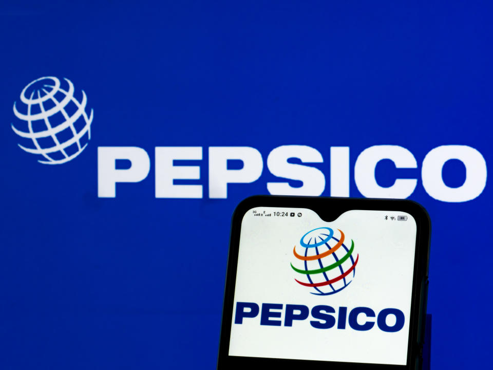 UKRAINE - 2021/05/22: In this photo illustration, a PepsiCo, Inc. logo seen displayed on a smartphone and in the background. (Photo Illustration by Igor Golovniov/SOPA Images/LightRocket via Getty Images)