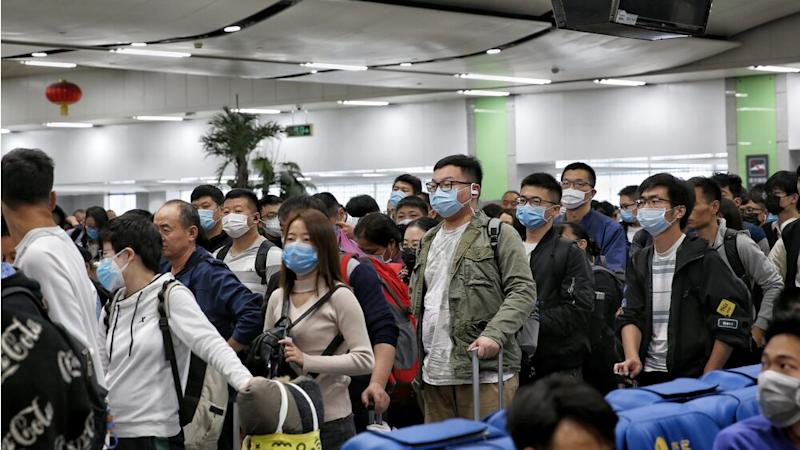 Passengers and staff at the Luohu railway station have put on masks in Shenzhen, China. | Barcroft Media/Getty Images