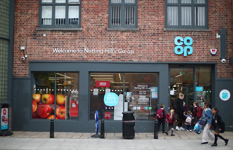 People walk past a Co-op supermarket in London, Britain, September 14, 2018. REUTERS/Hannah McKay