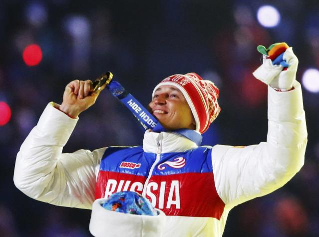 FILE PHOTO: Russian gold medalist Alexander Legkov celebrates as he receives his medal for the men's cross-country 50-kilometer mass start race during the closing ceremony for the Sochi 2014 Winter Olympics, Russia February 23, 2014. REUTERS/Lucy Nicholson/File Photo