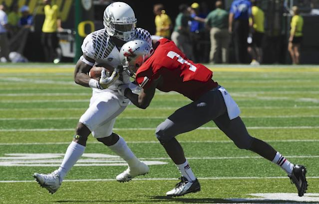 Oregon's Josh Huff (1) runs against Nicholls State's Ronald Tyler (3) during the first half of an NCAA college football game in Eugene, Ore., Saturday, Aug. 31, 2013. (AP Photo/Greg Wahl-Stephens)