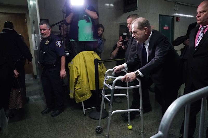 Harvey Weinstein leaves Manhattan Criminal Court, using a walker, following a hearing on December 11, 2019 in New York. | AFP via Getty Images