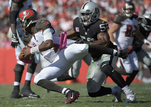 FILE - In this Oct. 30, 2016, file photo, Oakland Raiders defensive end Khalil Mack (52) sacks Tampa Bay Buccaneers quarterback Jameis Winston (3) during the second half of an NFL football game in Tampa, Fla. The Chicago Bears have acquired star pass rusher Khalil Mack from the Raiders on Saturday, Sept. 1, 2018, in a massive trade that sends two first-round draft picks to Oakland. A person with direct knowledge of the trade told The Associated Press that Oakland will get first-round selections in 2019 and 2020, a sixth-rounder next year and a third-rounder in 2020. Oakland also included its second-round selection in 2020. The person spoke on condition of anonymity because the trade had not been announced. (AP Photo/Phelan M. Ebenhack, File)