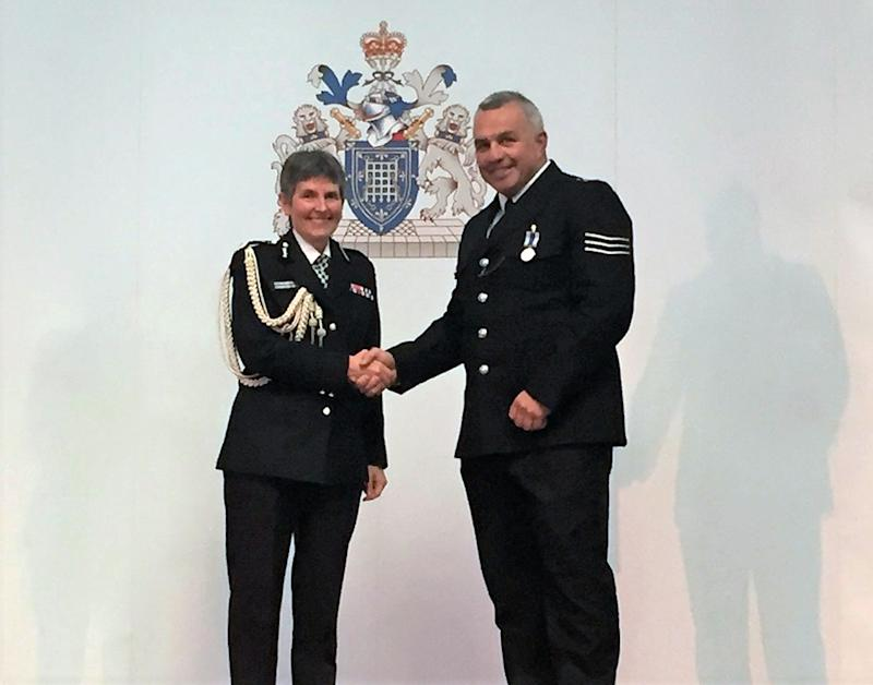 Metropolitan Police handout photo of Sergeant Matiu Ratana, known as Matt, receiving a long and good service medal from the Commissioner Cressida Dick on 31 May 2017. Sgt Ratana died after being shot at a police station in Croydon, south London.