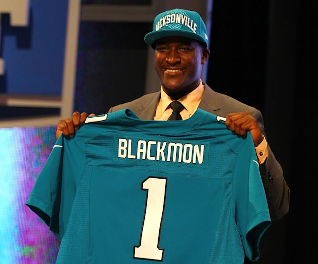 NEW YORK, NY - APRIL 26: Justin Blackmon from Oklahoma State holds up a jersey as he stands on stage after he was selected #5 overall by the Jacksonville Jaguars in the first round of the 2012 NFL Draft at Radio City Music Hall on April 26, 2012 in New York City. (Photo by Al Bello/Getty Images)