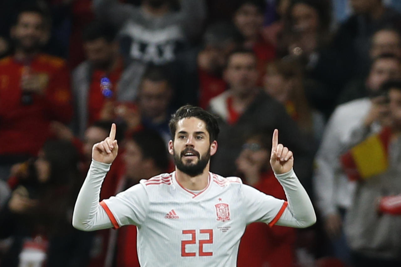 "In this March 27, 2018 file photo, Spain's Isco Alarcon celebrates scoring his side's third goal during the international friendly soccer match between Spain and Argentina at the Wanda Metropolitano stadium in Madrid, Spain. With Spain's golden generation all but gone, it's up to a group of talented youngsters that include Marco Asensio and Francisco ""Isco"" Alarcon to try to take over the Spanish national team and lead La Roja back to its glory days. (AP Photo/Francisco Seco, File)"