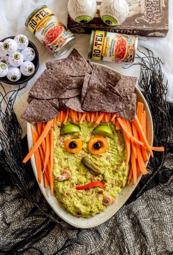 """<p>Get your chips or carrot sticks ready. This friendly witch is (almost) too cute to dig into. </p><p><a class=""""link rapid-noclick-resp"""" href=""""https://www.confettiandbliss.com/guacamole-halloween-appetizers/"""" rel=""""nofollow noopener"""" target=""""_blank"""" data-ylk=""""slk:GET THE RECIPE"""">GET THE RECIPE</a></p>"""