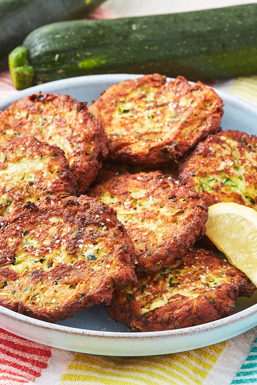 """<p>These simple fritters are quickly shallow-fried and make a great side dish for dinner or a light lunch. They can even be easily adapted to fit whatever you're looking for!</p><p>Get the <a href=""""https://www.delish.com/uk/cooking/recipes/a32954264/easy-zucchini-cakes-recipe/"""" rel=""""nofollow noopener"""" target=""""_blank"""" data-ylk=""""slk:Courgette Cakes"""" class=""""link rapid-noclick-resp"""">Courgette Cakes</a> recipe.</p>"""