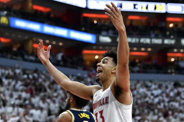 Louisville forward Jordan Nwora (33) encourages the crowd during the second half of an NCAA college basketball game against Michigan in Louisville, Ky., Tuesday, Dec. 3, 2019. Louisville won 58-43. (AP Photo/Timothy D. Easley)