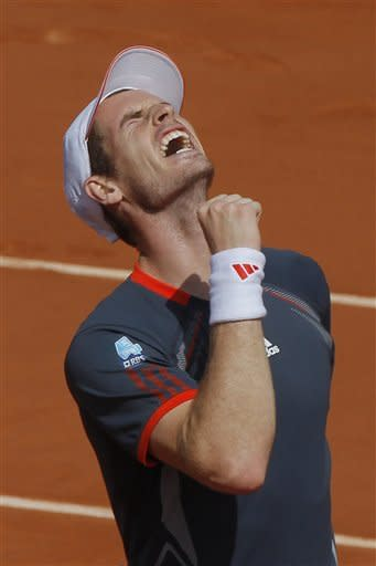Britain's Andy Murray celebrates winning his third round match against Santiago Giraldo of Colombia at the French Open tennis tournament in Roland Garros stadium in Paris, Saturday June 2, 2012. Murray won in three sets 6-3, 6-4, 6-4. (AP Photo/Michel Euler)
